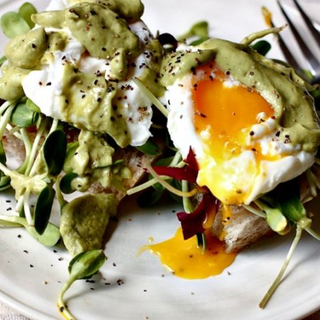 Poached eggs on Sourdough toast with avocado sauce via @danielleomar