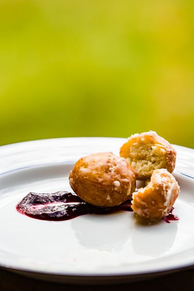 potato donut holes with boysenberry sauce